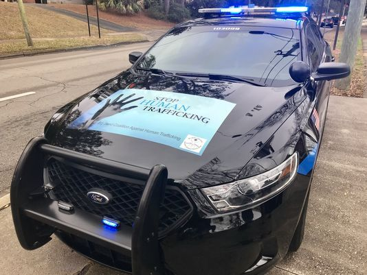 human trafficking awareness police squad car wrap